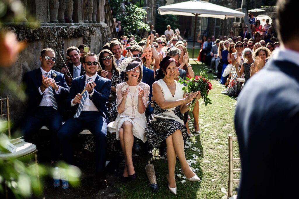 wedding guests during ceremony at wedding in villa gamberaia