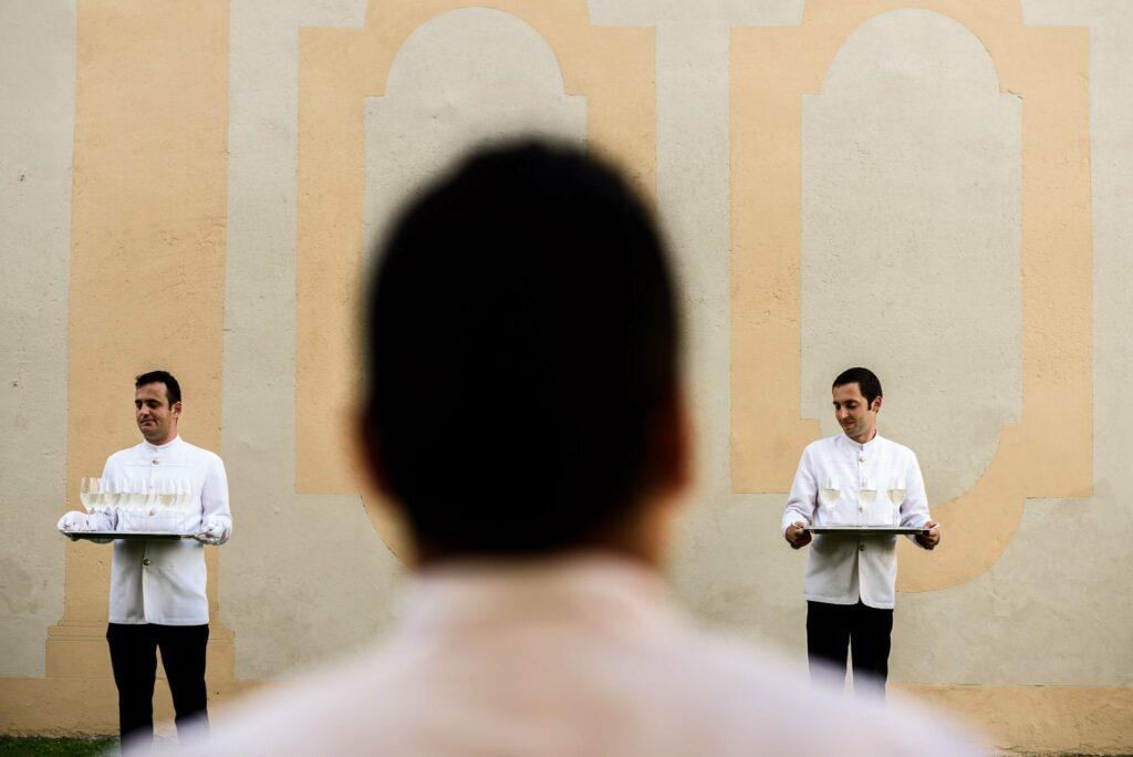 waiters during the aperitif at wedding in villa gamberaia