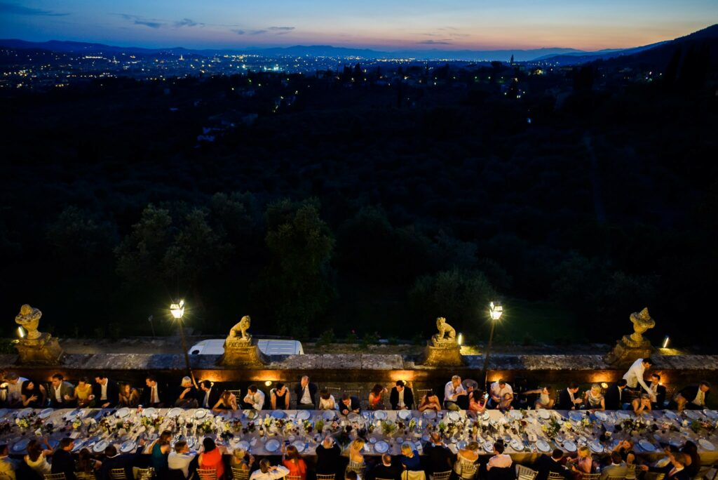 imperial wedding table at villa gamberaia with a view of florence