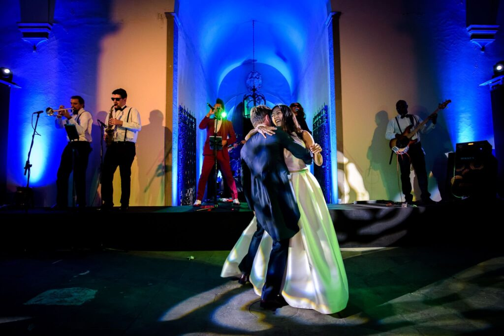 bride and groom first dance with the live band playing