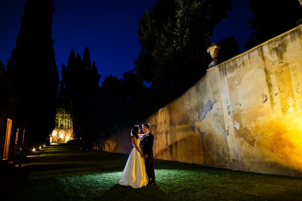 couple portait at night at the end of wedding in villa gamberaia