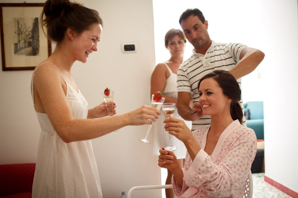 bride toasting with her sister during getting ready ravello wedding