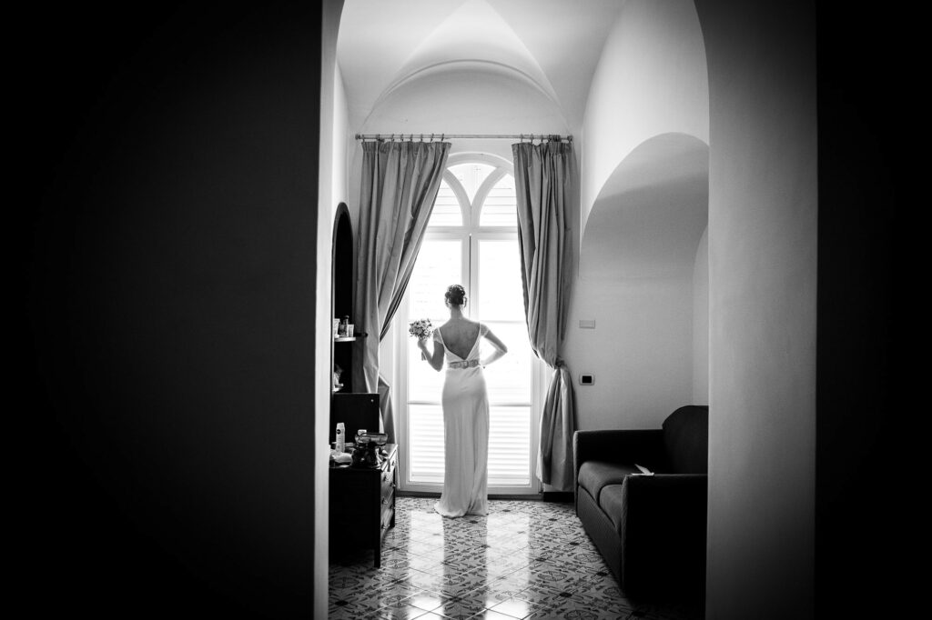 a picture shot by ravello wedding photographer of the bride alone ready to leave her hotel room to go the ceremony