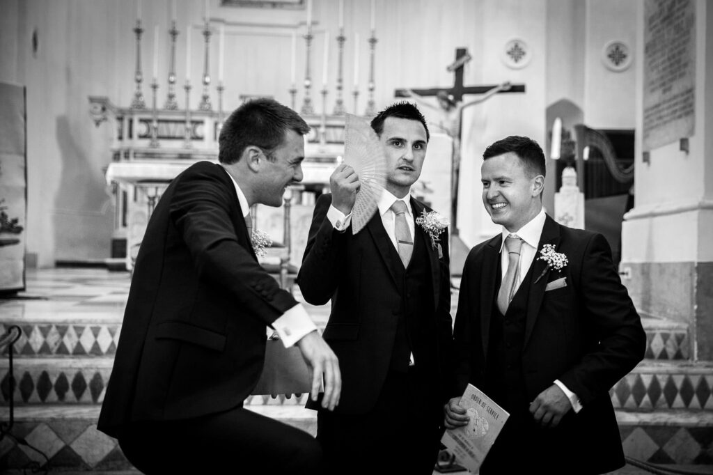 groom waiting for the bride in the ravello cathedral together with his best men