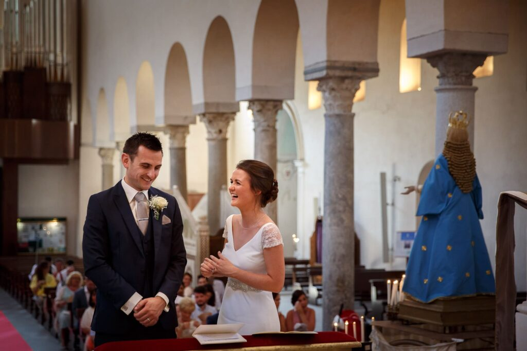 bride and groom smiling during the ceremony at the cathedral of ravello