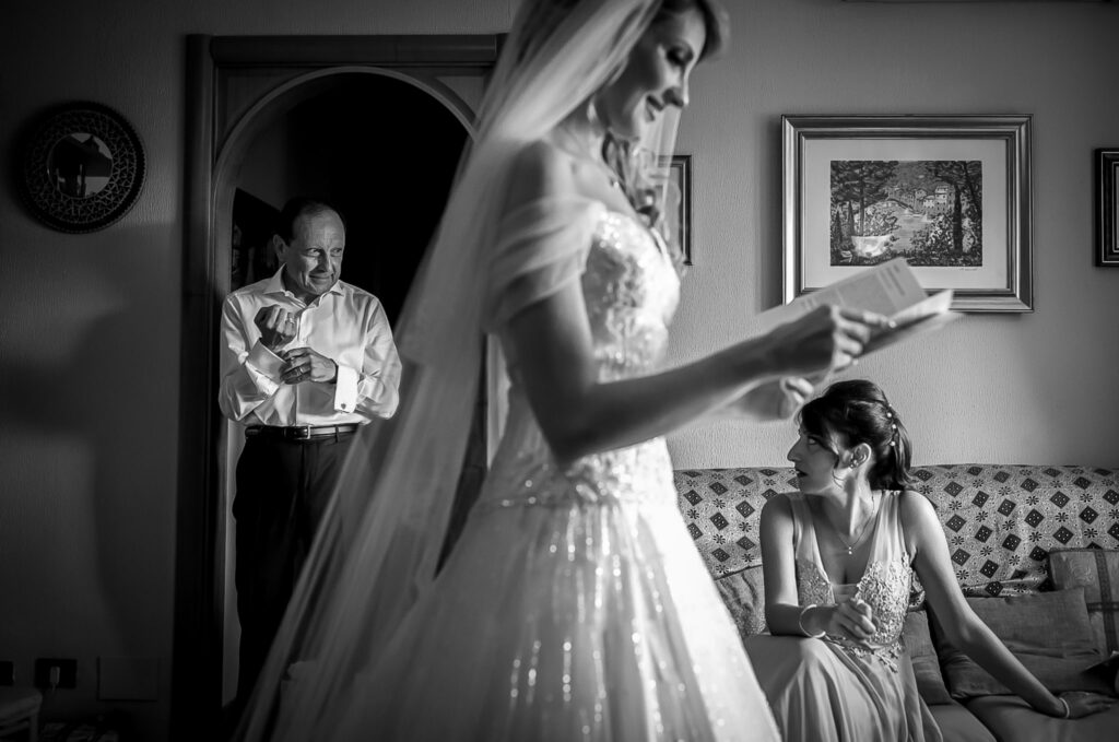 bride with wedding dress ready for her relaxed summer wedding in rome reading a letter