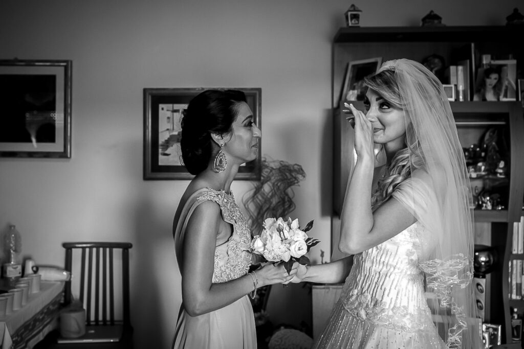 bride getting moved facing her bridesmaid
