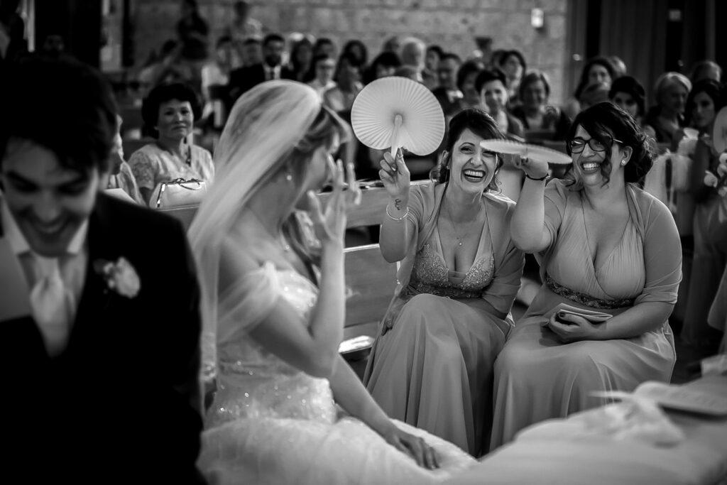 witnesses with fans in church during the wedding in rome