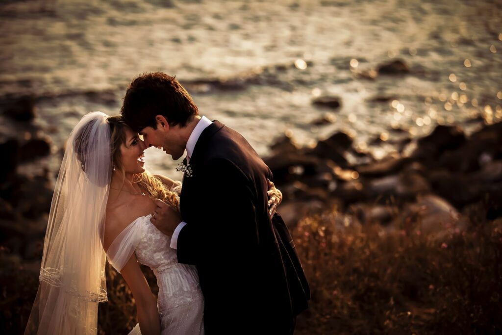 portrait of married couple on the beach in santa marinella at sunset