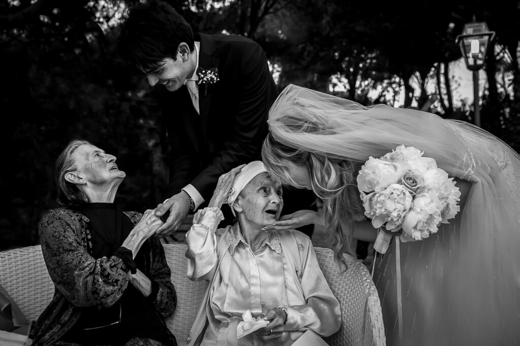 spouses greeting their grandmothers at the summer wedding in rome