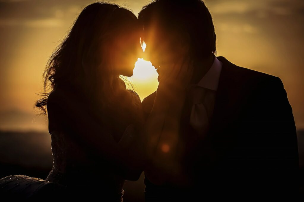 bride and groom kissing at dawn during the post-wedding photo shoot
