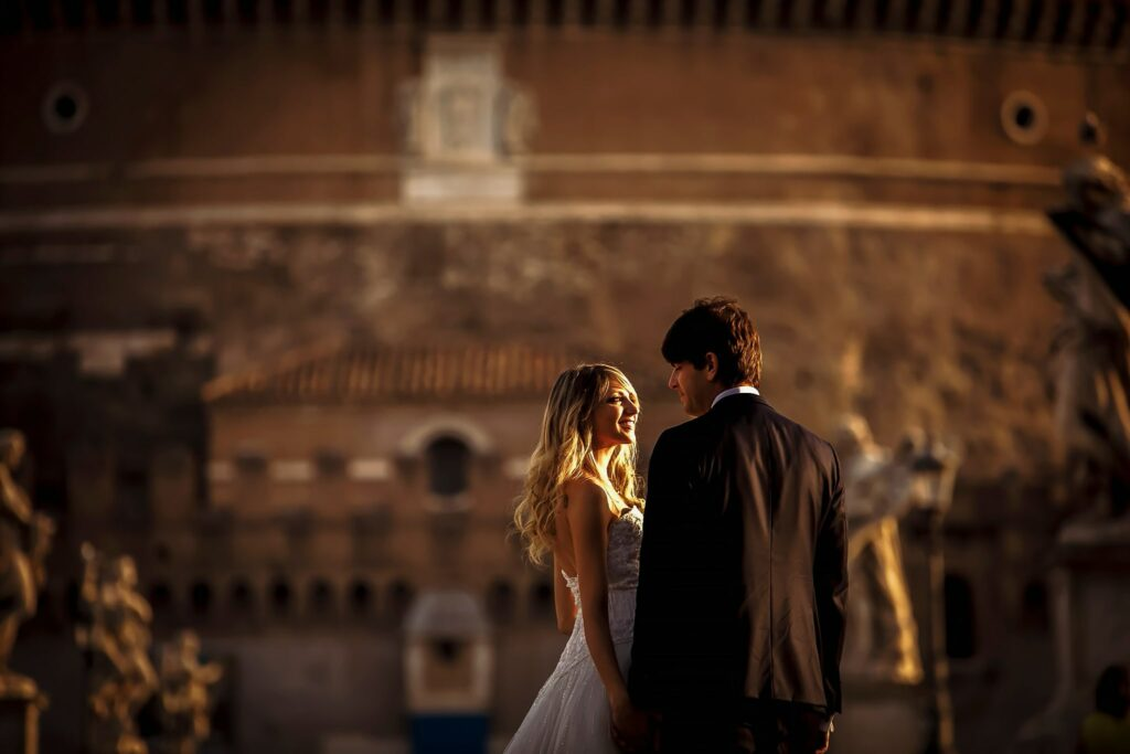bride and groom on ponte santangelo in rome