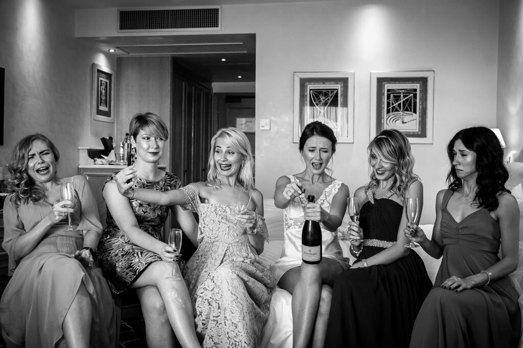 bride friends and bridesmaid toasting with champagne