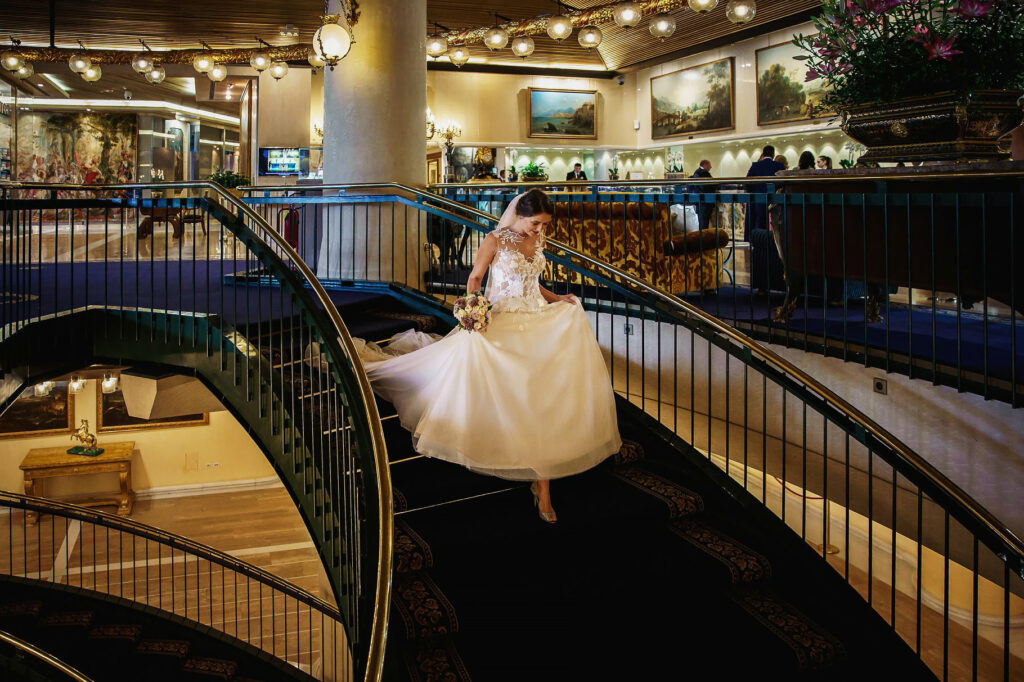 bride walking down the stairs of the Cavalieri hilton hotel