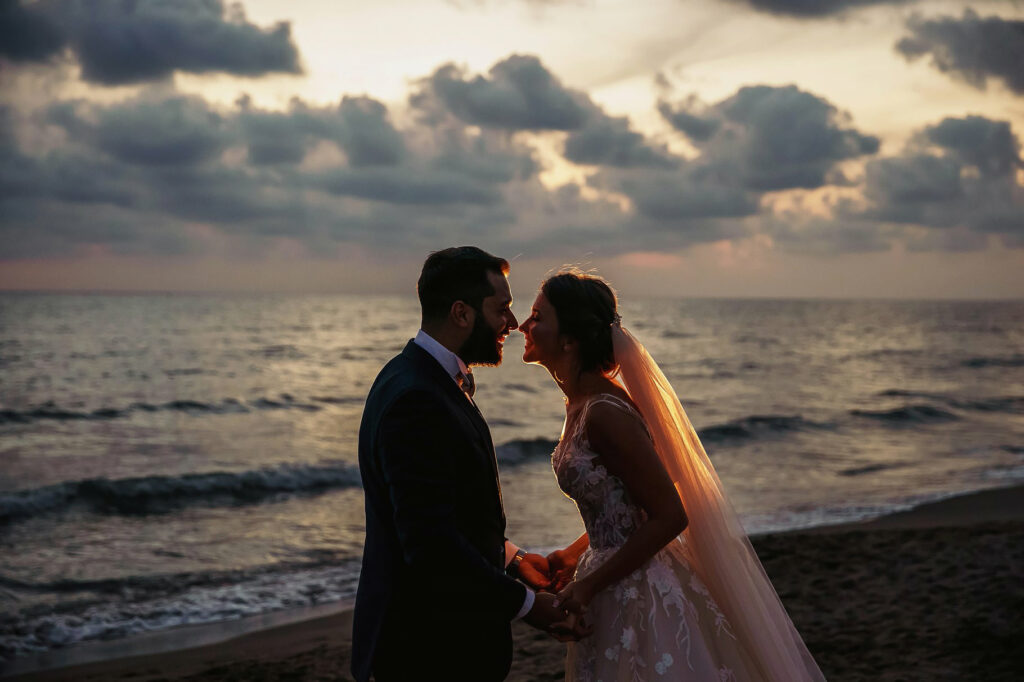 couple portrait on the beach at sunset after the ceremony