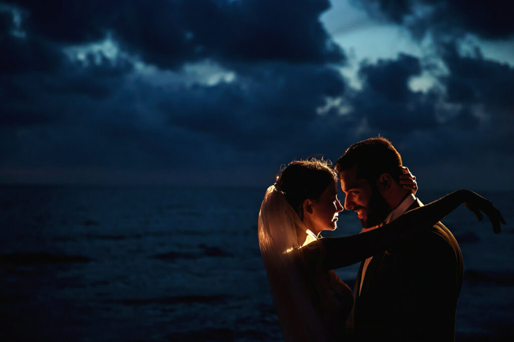 couple portrait on the beach at night after the ceremony