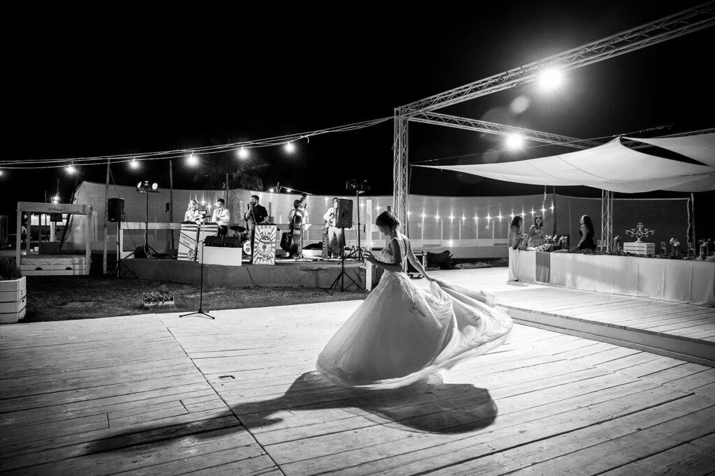 the bride dances alone at the beach wedding