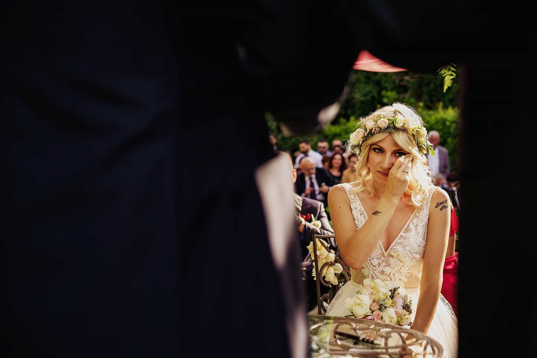 the bride getting moved during the groom speech at the outdoor wedding at villa rosantica