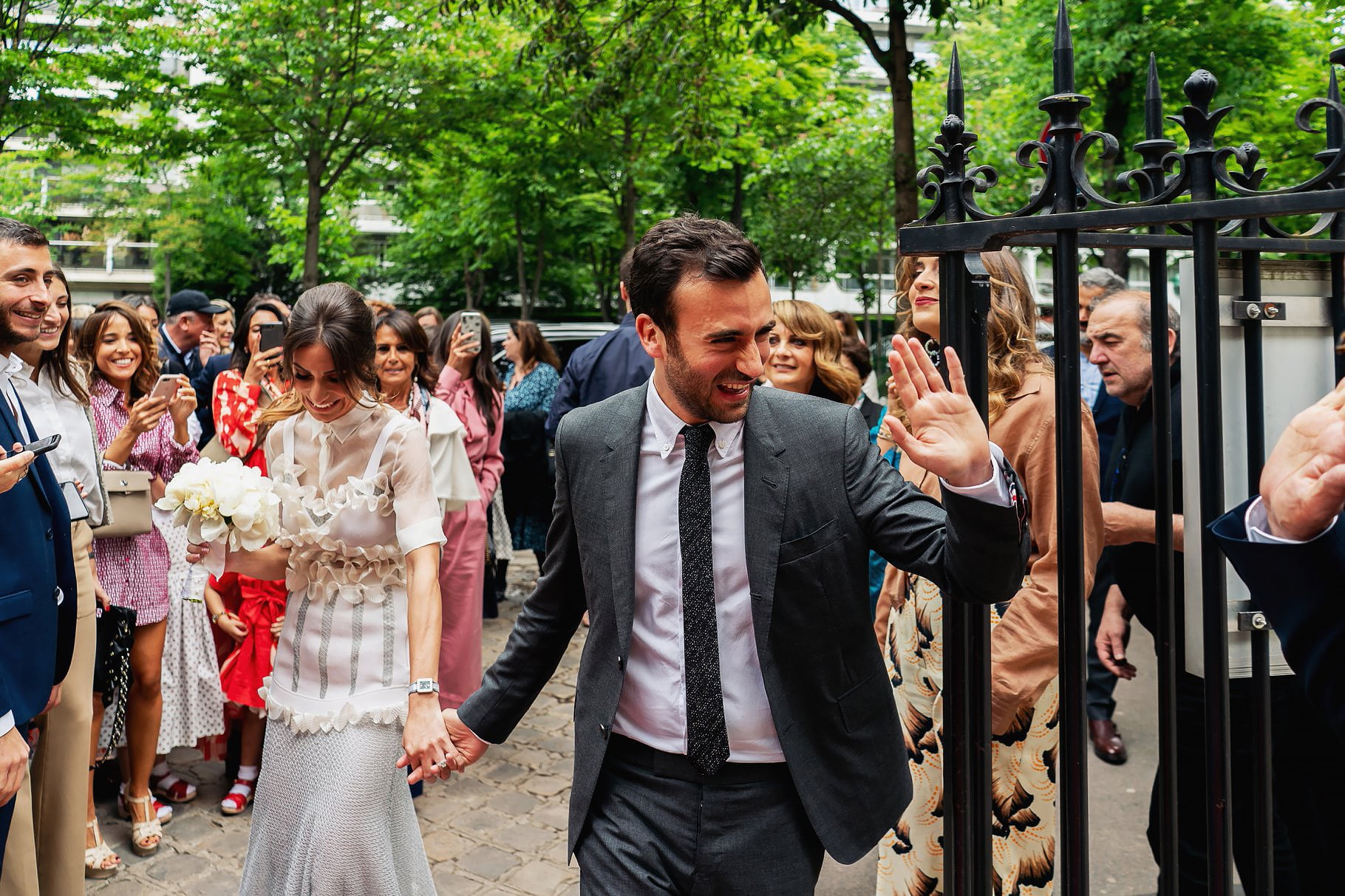 bride and groom entering the location of the ceremony of their wedding in paris