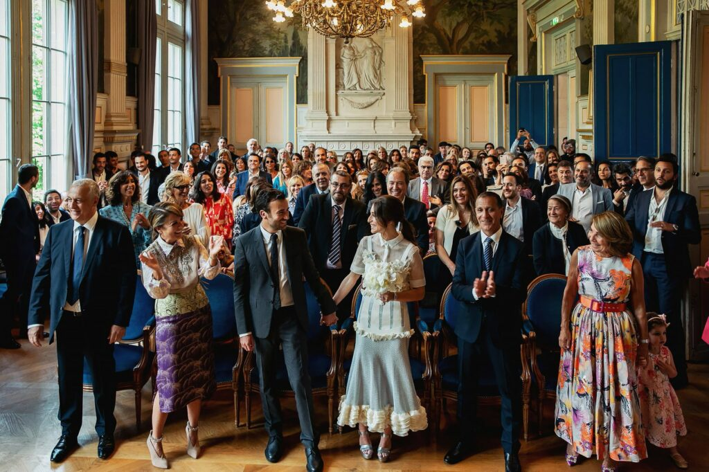 bride groom and guests during the civil wedding ceremony in paris in the town hall