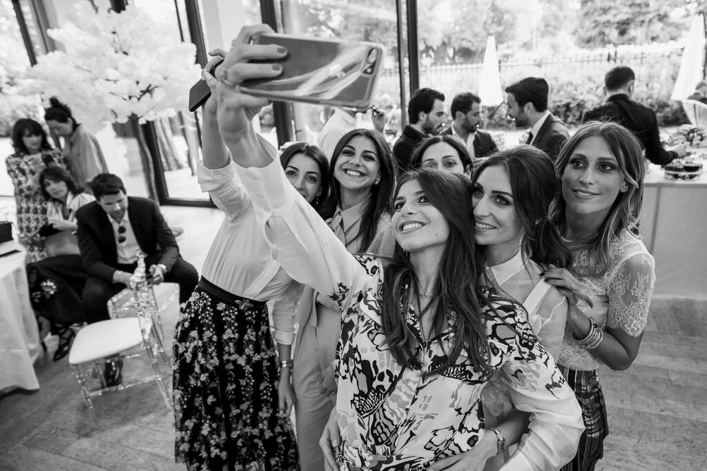bride shooting a selfie with her friends