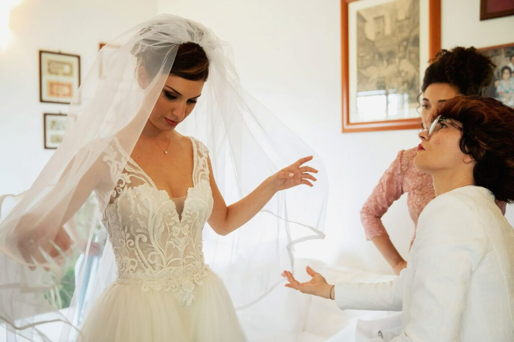 bride wearing the bridal veil for the wedding of a football player