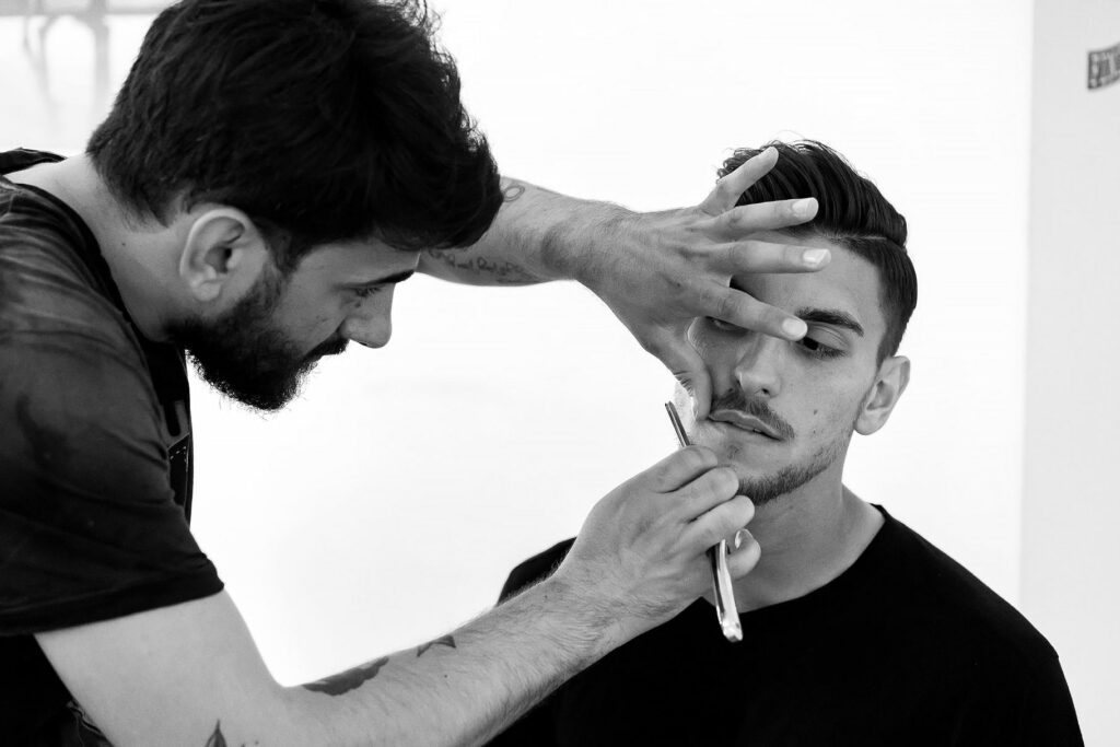 barber adjusts the groom beard before the ceremony