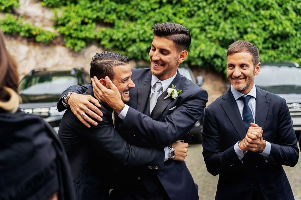 the groom lorenzo pellegrini with the roma player alessandro florenzi before the ceremony starts
