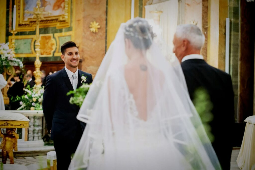 football player lorenzo pellegrini watches the bride veronica arriving at the altar