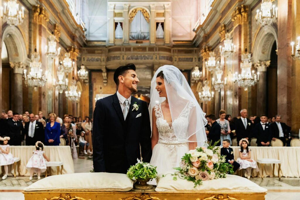happy and in love newlyweds look at each other in church during the ceremony at santi giovanni e paolo