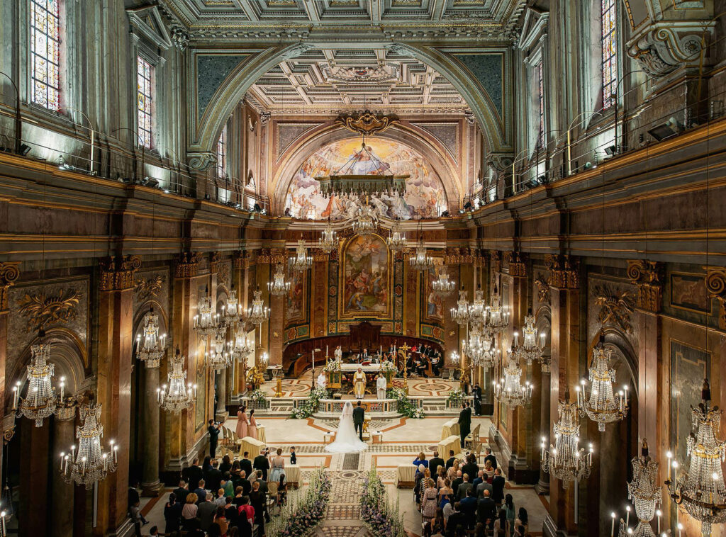 view of the interior of church of the chandeliers at the wedding of a football player lorenzo pellegini