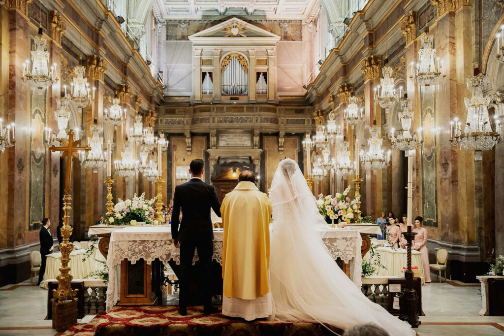 the holy communion of the spouses in the church of the chandeliers at the wedding of lorenzo pellegrini