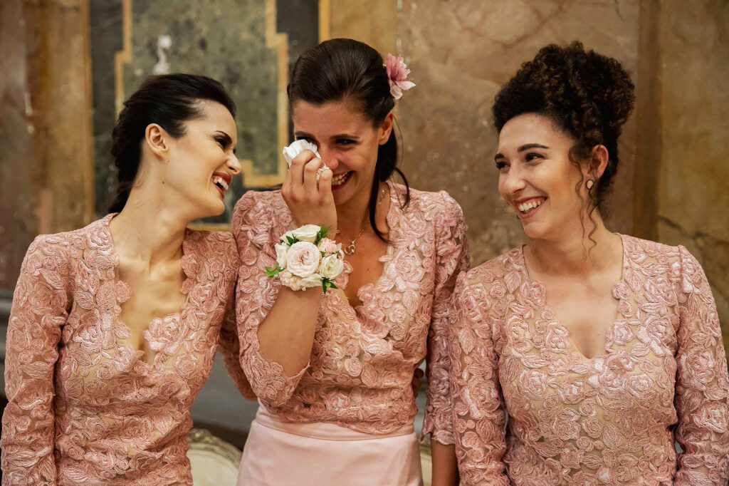 bridesmaid laughing and crying with emotion