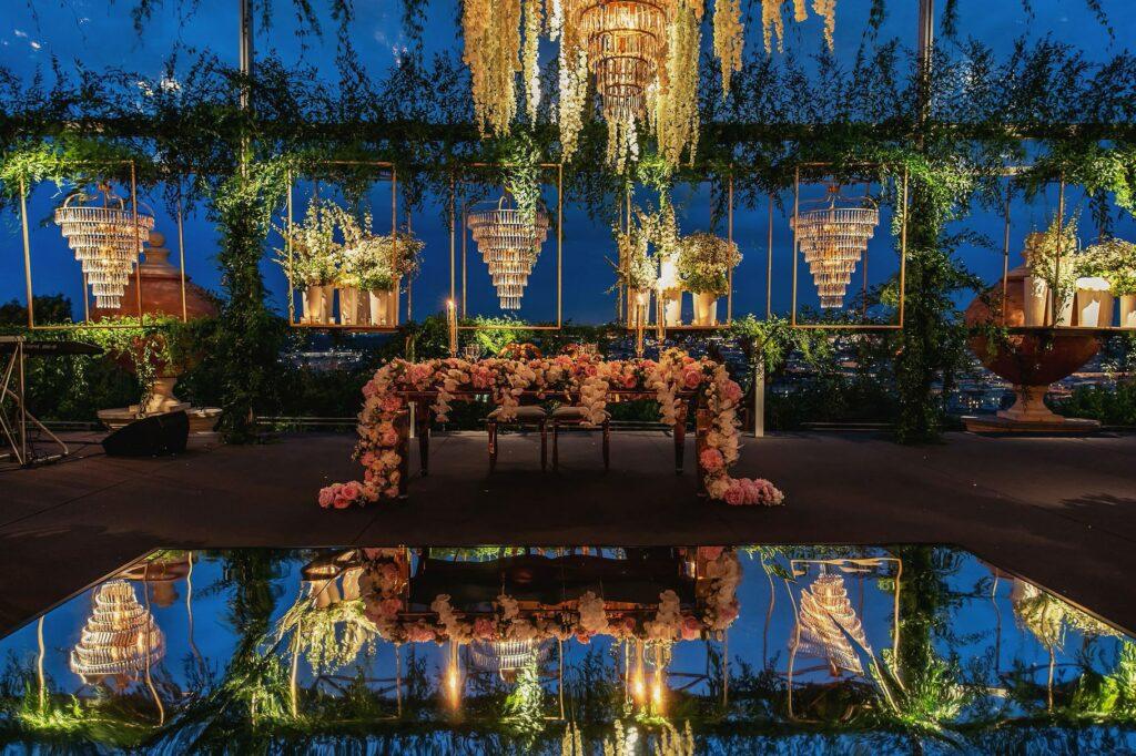 majestic floral arrangements at bridal dinner table at villa miani