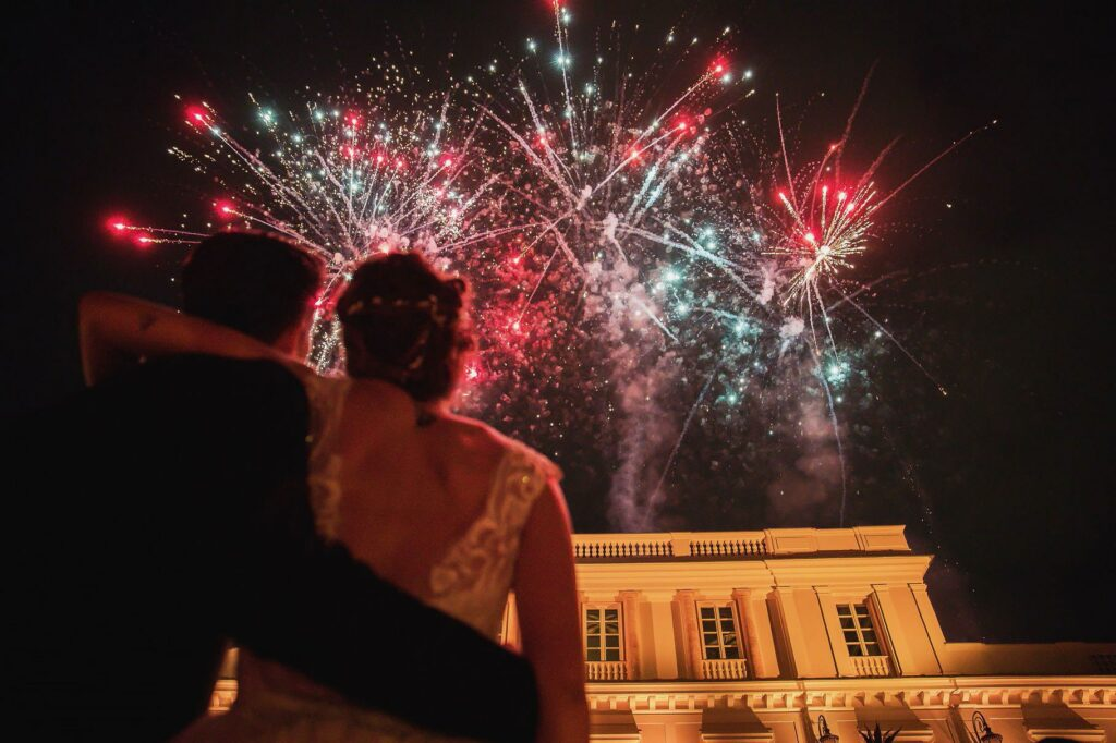 bride and groom watching fireworks at villa miani