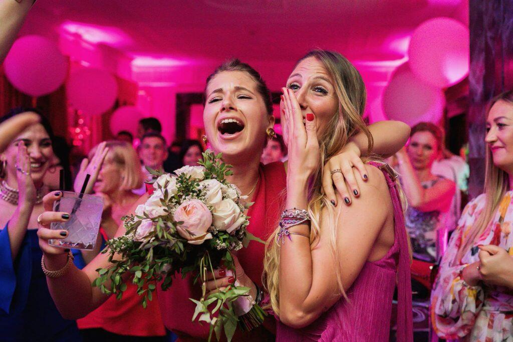 wedding guest receiving the bouquet