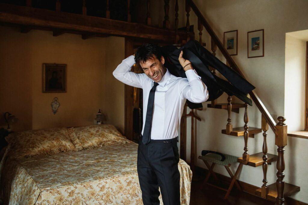 the groom wears kledi kadiu wedding jacket