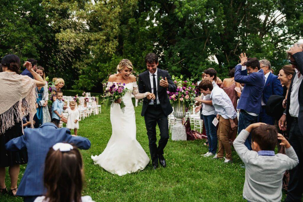 throwing confetti at the exit of kledi kadiu wedding ceremony