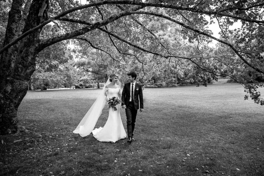 newlyweds strolling in the park of Tenuta San Liberato