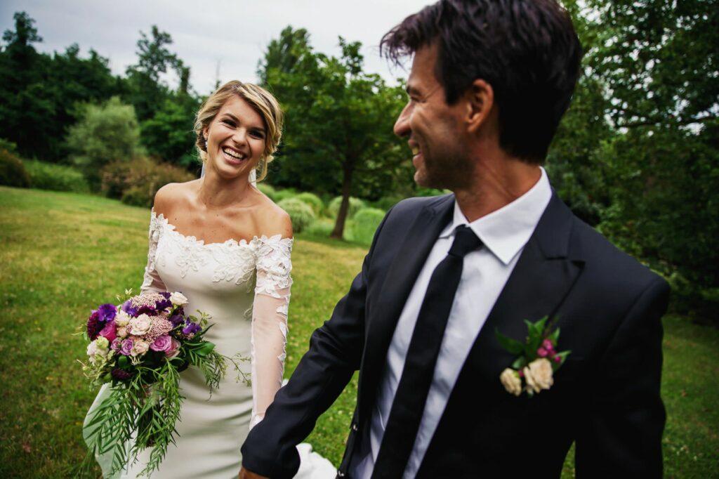 bride and groom walking hand in hand after kledi kadiu wedding