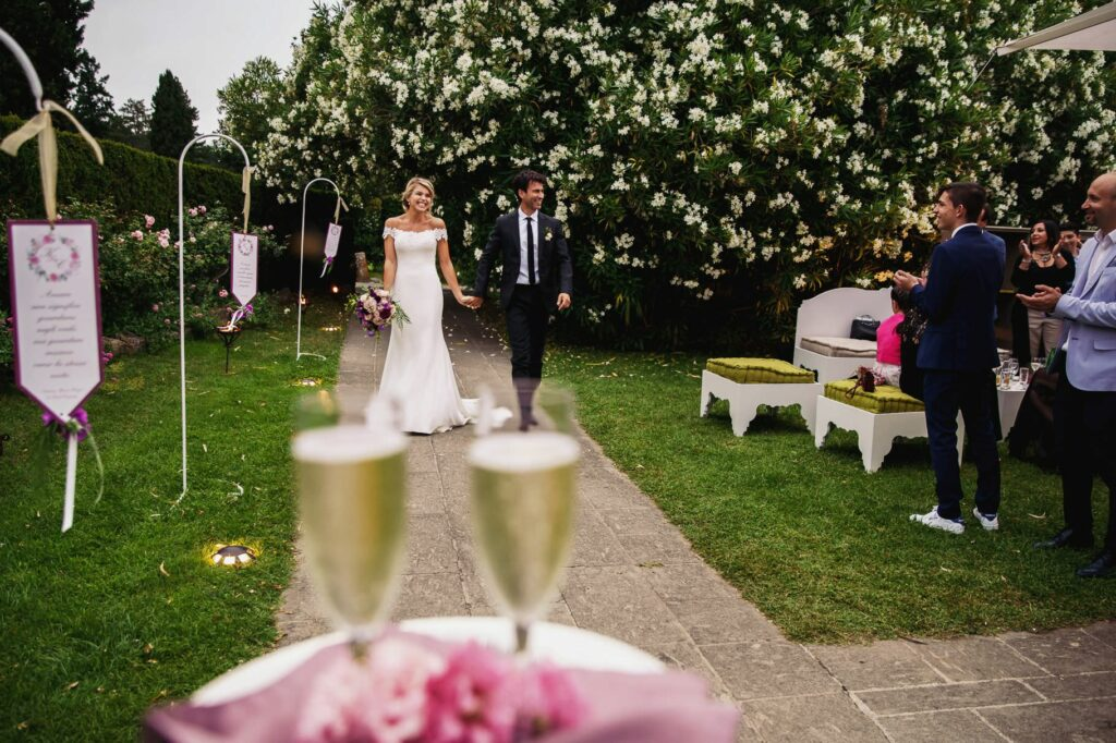 newlyweds enter the reception yard