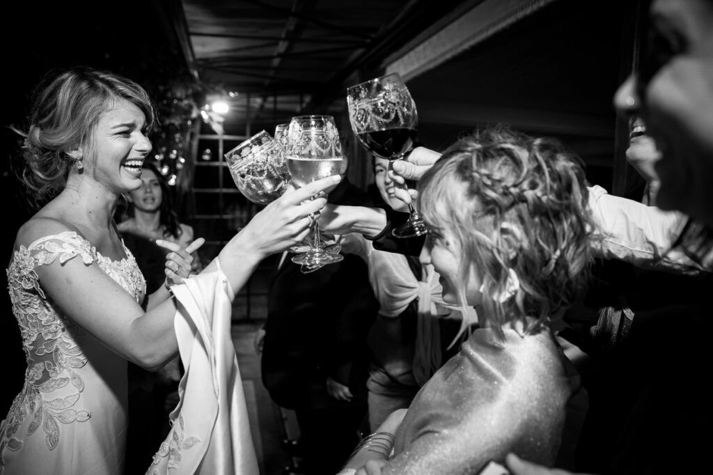 bride joyfully toasting with guests