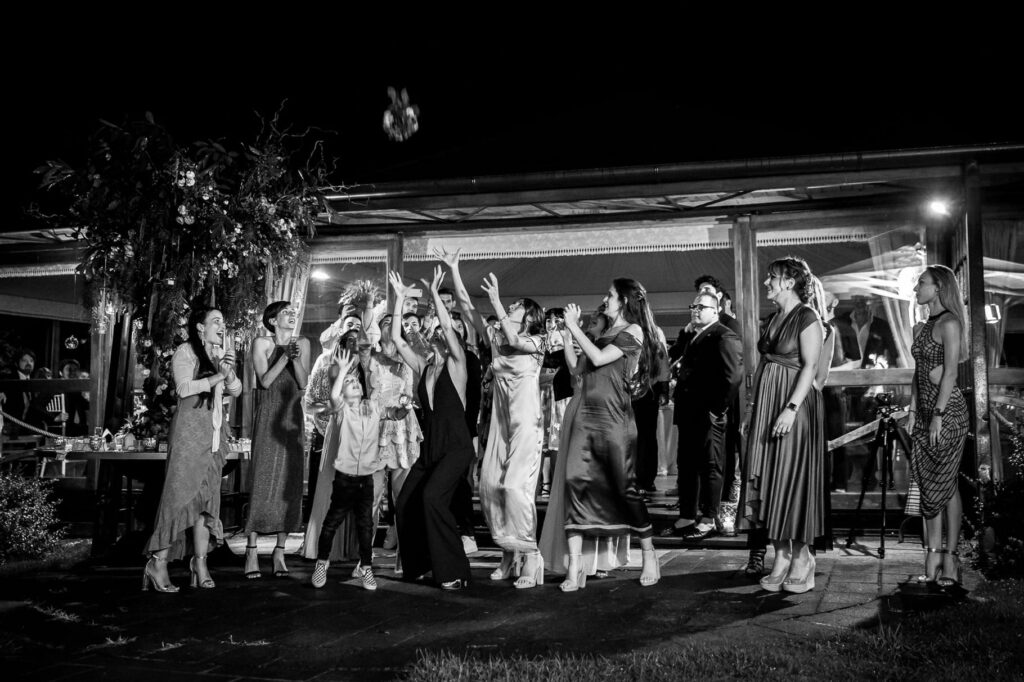 throwing the bride bouquet at kledi kadiu wedding