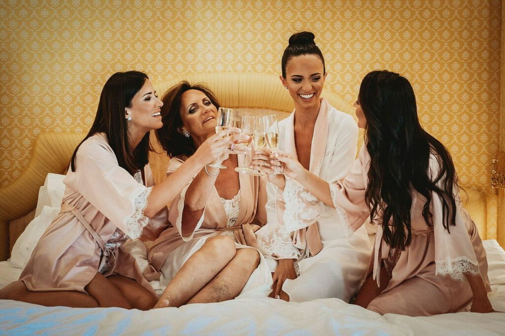 bride toasts with bridesmaids and mother during the getting ready at rome cavalieri hilton hotel