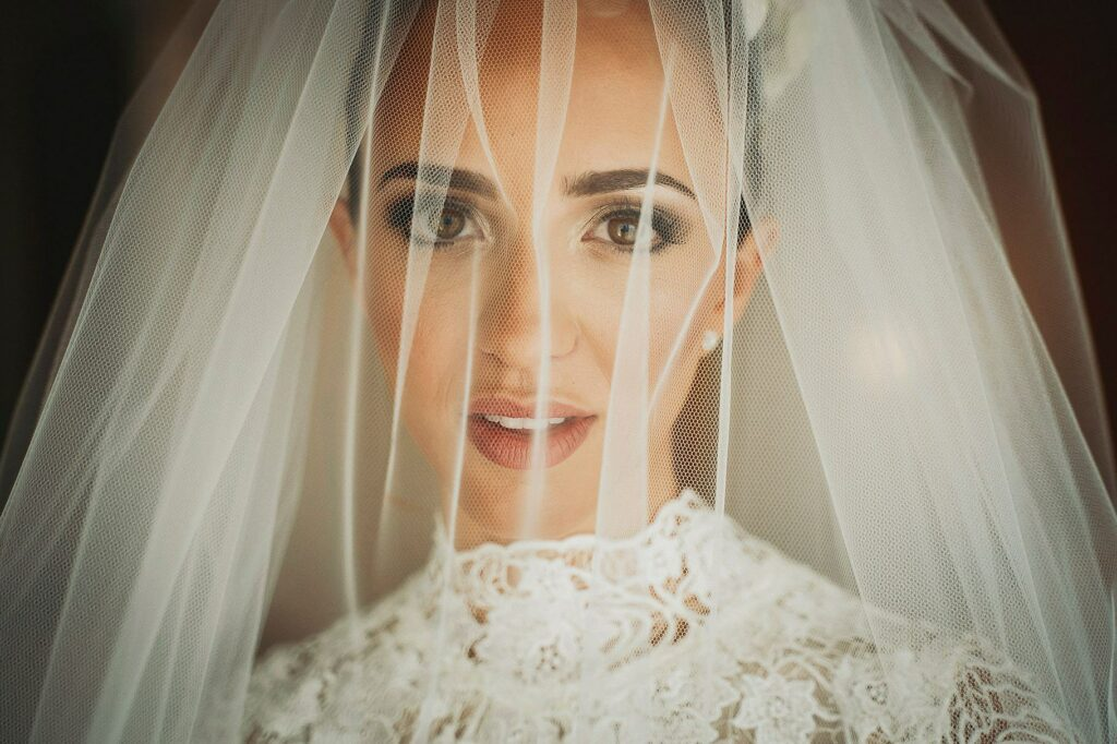 portrait of the bride with the veil just before going to the wedding ceremony of the spanish-italian wedding