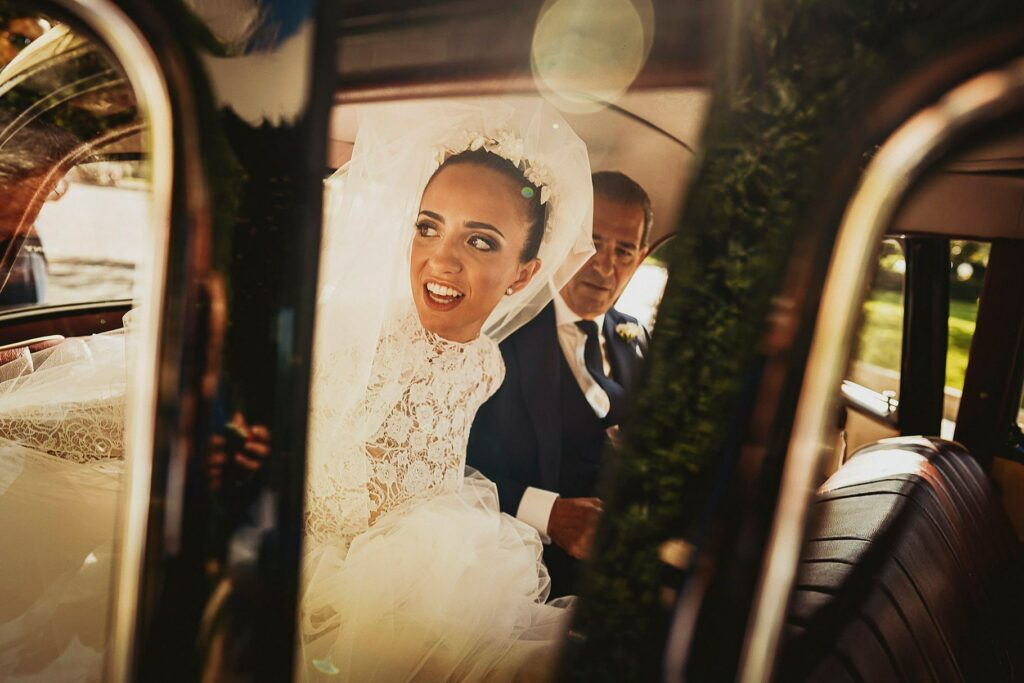 bride is in the car with her father going to wedding ceremony
