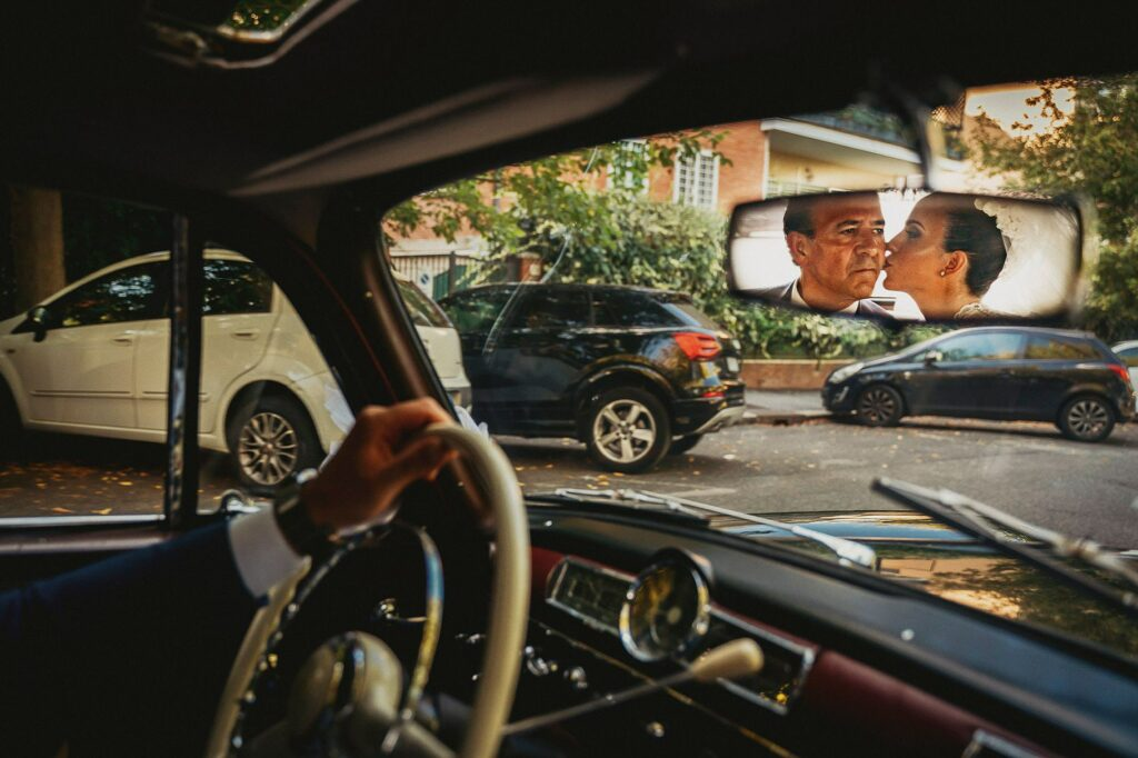 bride is in the car with her father going to wedding ceremony she kisses her father