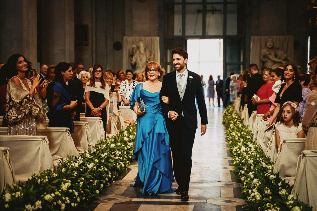 groom entering the church with his mother