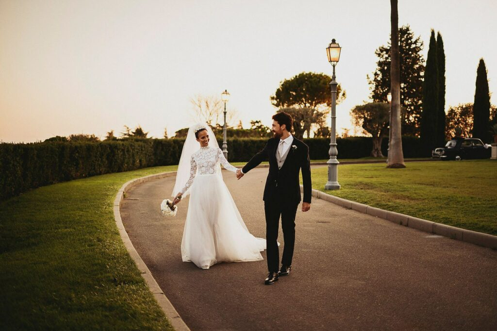 the newlyweds stroll in the gardens of Villa Miani