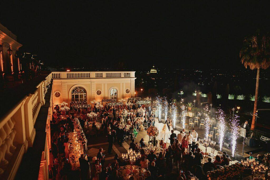 top view of villa miani at wedding cake cutting with fireworks during spanish-italian wedding at Villa Miani